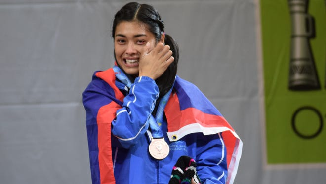In this file photo, Kimberly Taguacta wipes away tears after receiving her bronze medal at the 2015 Pacific Games. Taguacta will represent Guam at the 2015 International Weightlifting Federation World Championships on Nov. 21.