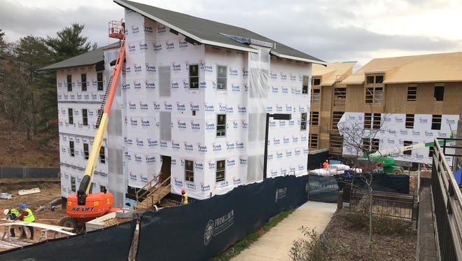 UNC Asheville is building five apartment style, on campus housing units that will have a total of 294 beds and a cost of $33.8 million.