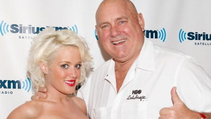 Bunny Ranch founder Dennis Hof wants to open a brothel in Phoenix. In this 2011 photo, he is seen with Cami Parker at SiriusXM Studio  in New York City.
