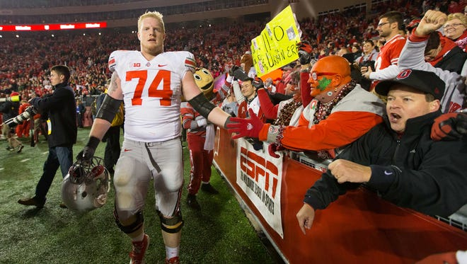 Nov 17, 2012; Madison, WI, USA;  Ohio State Buckeyes offensive lineman Jack Mewhort (74) celebrates with fans following the game against the Wisconsin Badgers at Camp Randall Stadium.  Ohio State defeated Wisconsin 21-14 in overtime.  Mandatory Credit: Jeff Hanisch-USA TODAY Sports