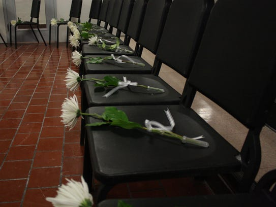 Flowers were placed on seventeen empty chairs at Binghamton