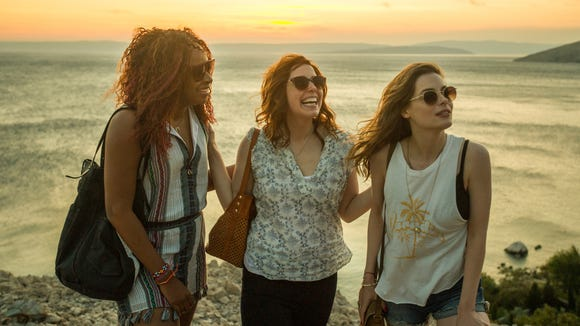 "Vanessa Bayer (center) steals the show with physical comedy and incredible timing in Netflix's ""Ibiza."""