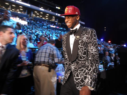 Andrew Wiggins walks off the stage after being selected as the number ... Jabari Parker Lebron James