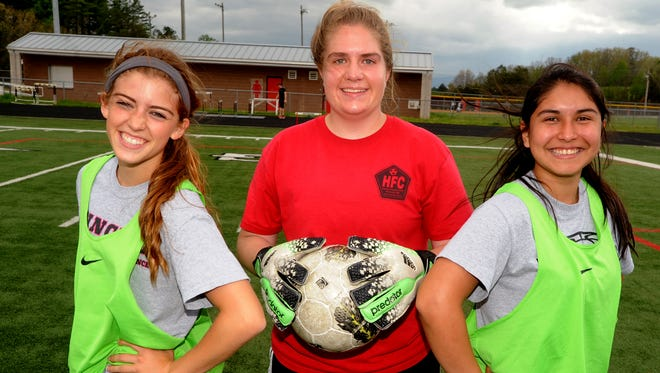 North Buncombe soccer players (from left to right) Lindsey Greene, Emily Jones and Maite Gonzalez.