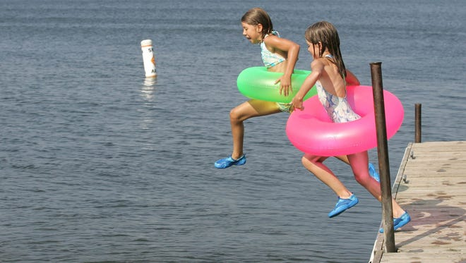 Kids swim at the Iowa Great Lakes area.