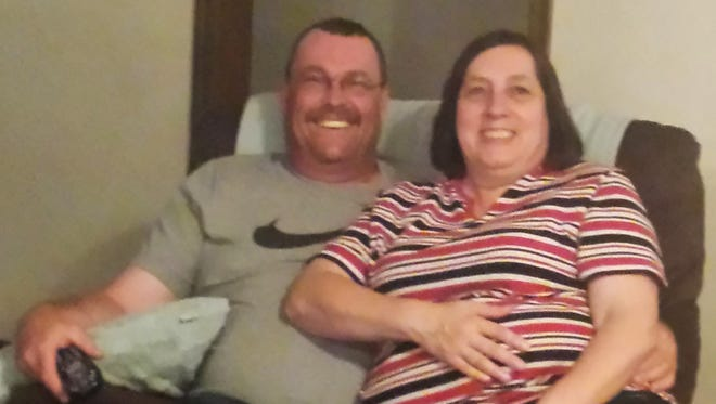 In this undated photo provided by the Hufford family, Colleen Hufford, right, is pictured with her husband, K.C. Hufford, relaxing in their home in Moore, Okla. Colleen Hufford was recently slain during a workplace incident at Vaughan Foods in Moore, Okla.
