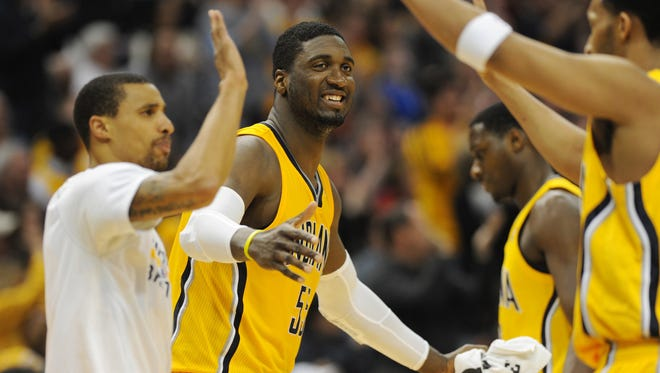 Indiana's George Hill and Roy Hibbert come off the bench to congratulate teammates at the end of the third quarter with their 91-70 lead, as the Indiana Pacers defeated the Los Angeles Lakers 118-98 at Bankers Life Fieldhouse Tuesday February 25, 2014.