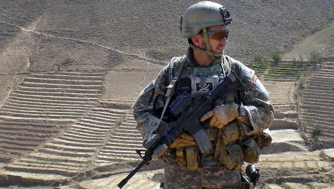 Kryn Miner in Afghanistan. Miner, an Army veteran who suffered from post-traumatic stress disorder,  was shot to death in Essex, Vt., by one of his children in April after threatening to kill the family. His wife, Amy, says the Veterans Affairs health system must do more to help veterans who struggle with PTSD after returning home.