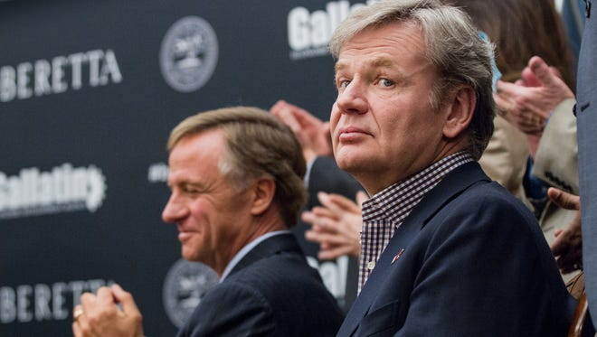 Franco Gussalli Beretta, right, a director of Beretta USA, and Tennessee Gov. Bill Haslam applaud during the January 2014 announcement of a new firearms plant being built in the state.