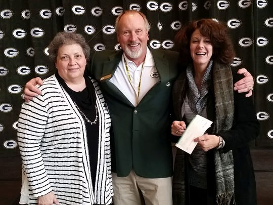 The Green Bay Packers Foundation presented grants to Bethesda Lutheran Communities' thrift shops in Appleton and Green Bay during the foundation's annual luncheon Dec. 8 at the Lambeau Field Atrium in Green Bay. From left: Mary Beth Murphy, manager at the Appleton thrift store; Terry Fulwiler, chairman of the Green Bay Packers Foundation; and Kelly Udell, manager at the Green Bay thrift store.