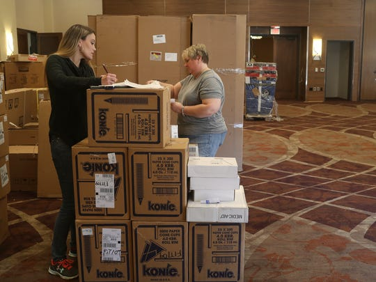 HPG International assistant project manager Lindsay Smith, and senior project manager Anissa McMaster take inventory Monday of supplies for the Sheraton Redding Hotel at the Sundial Bridge. The hotel is scheduled to open in early January.