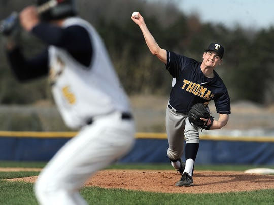 Webster Thomas' Logan Harasta, right, sends a pitch toward home plate.