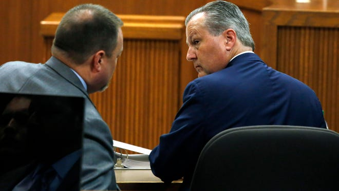 Attorney Lance Bell and Mike Hubbard talk before the start of the second day of the Alabama House Speaker's trial on Wednesday, May 25, 2016, in Opelika, Ala. (Todd J. Van Emst/Opelika-Auburn News via AP, Pool)