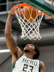 Sterling Brown of the Wisconsin Herd dunks a shot Friday