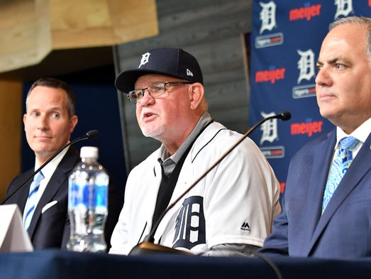 Manager Ron Gardenhire, center, answers questions between