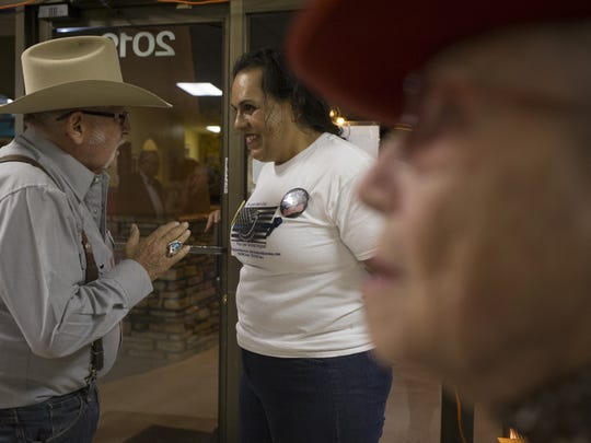 "Joanne Selena Lopez Cervantez (center) talks with an attendee after speaking at a ""Believers in Trump"" meeting last month in Wickenburg."