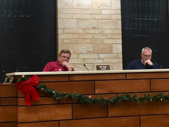 St. Francis Aldermen Ray Klug and Mike McSweeney listen