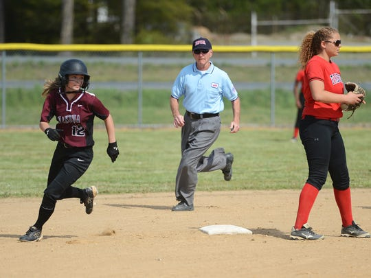 Nandua's Sarah Gepes rounds second base after a steal on a pass ball during the Warriors' softball game with Arcadia in Oak Hall, Va. on Tuesday, April 26, 2016. Nandua won the game 25-0.