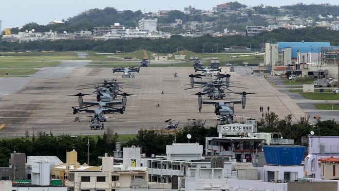U.S. Marine Corps MV-22 Osprey aircrafts sit on the tarmac at U.S. Marine Corps Air Station Futenma surrounded by overcrowded residential areas in Ginowan on Okinawa Island, southwestern Japan, May 19, 2015.