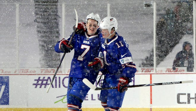 U.S. forward Brady Tkachuk (7) celebrates his goal with forward Casey Mittelstadt (11) during the third period against Canada in an IIHF world junior championships hockey game.
