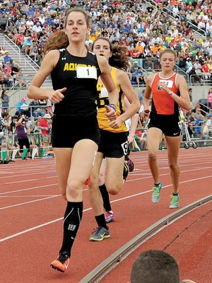 St. Thomas Aquinas' Athena Welsh wins the 1,600 meters at the 2016 OHSAA Division III State Track and Field Championships.