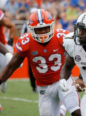 Florida Gators linebacker David Reese (33) defends during a game earlier this season.