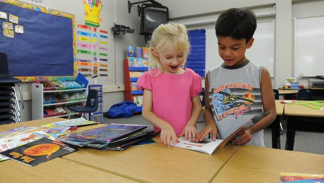 Student Hannah Welco, 6, and her classmate Alex Baker, 5, look through books in 2014 while visiting their first grade classroom at the new Incline Village Elementary School.