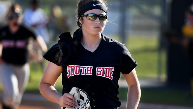 South Side's Kayla Beaver runs back to the dugout after an inning of Thursday's game against Scotts Hill. South Side defeated Scotts Hill, 4-0.