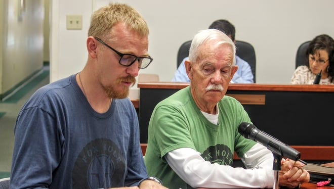 Foxhole Homes founder Ted Brinegar and Vice-President  Dwight Harp go over the county's new ordinance, the Sustainable Development Test Site Act, at the county's regular commission meeting Thursday morning.