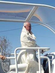 Pope Francis travels through downtown Juárez Wednesday