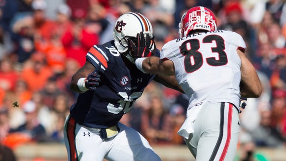 Georgia tight end Jeb Blazevich (83) stiff arms Auburn Tigers linebacker Tre' Williams (30) during the the NCAA football game between Auburn Tigers and Georgia on Saturday, Nov. 14, 2015, in Auburn, Ala.