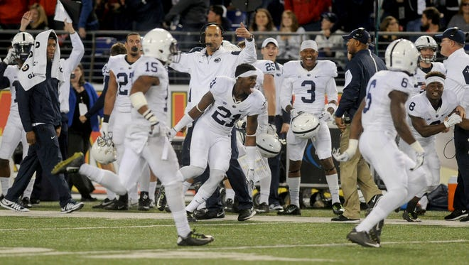 Players on the Penn State sidelines celebrate during the Nittany Lions' 31-30 victory against Maryland in Baltimore last season.