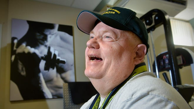 Marine Corps veteran and stroke survivor Randy Falknor smiles as he talks Wednesday, July 20, 2016, about his experiences as a gold medalist in the National Veterans Wheelchair Games.