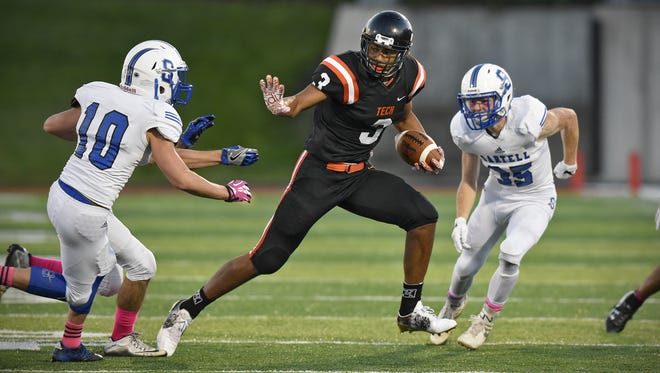 Tech's Brevyn Spann-Ford carries the ball during the Friday, Sept. 9, game at Husky Stadium in St. Cloud.