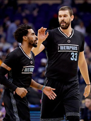 Memphis Grizzlies center Marc Gasol (33) congratulates guard Mike Conley during the second half against the Phoenix Suns, Monday, Jan. 30, 2017, in Phoenix.