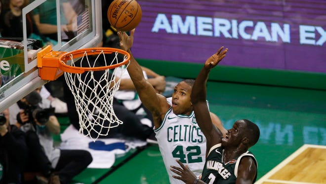 Milwaukee Bucks forward Thon Maker (7) shoots the ball as Boston Celtics forward Al Horford (42) defends during the second quarter in game seven of the first round of the 2018 NBA Playoffs at TD Garden.