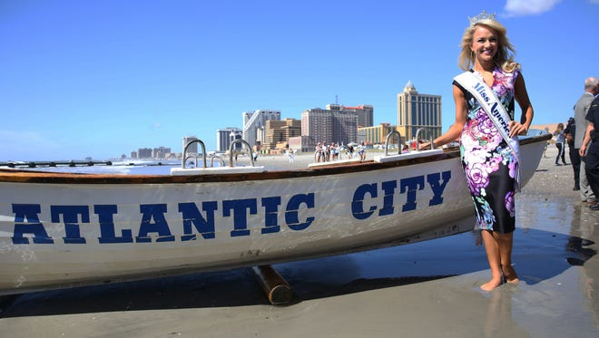Miss America 2017 Savvy Shields poses for the media during the traditional toe dip in Atlantic City Monday.