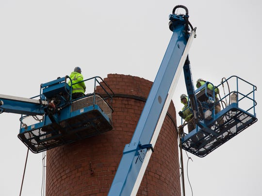 Workers demolish the stack for the former coal boiler Wednesday, Dec. 30, 2015 at Cargill salt in St. Clair. Cargill is investing $10 million into its facility on Riverside Avenue to reduce its emission footprint.