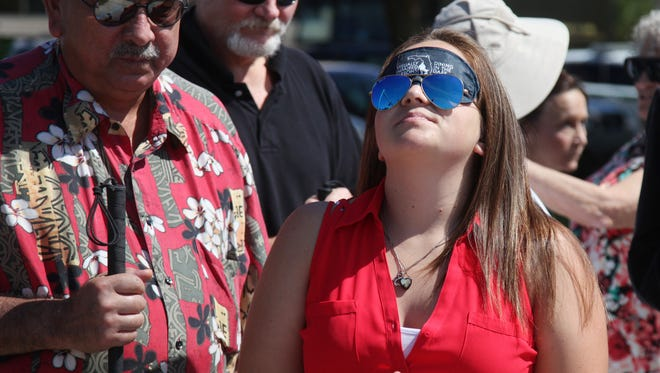 Andrea Ayala, Children's Program Coordinator for The Lighthouse of SWFL wears a blindfold while navigating the intersection of Pine Island Road and U.S. 41 during a training session organised by The Lighthouse of SWFL to help those with sight to understand the challenges faced by the blind.