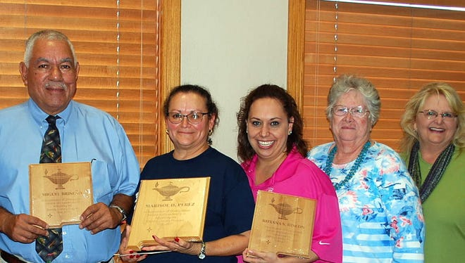 The Deming Literacy Program has been in existence for 27 years. The Deming Literacy Center at 2301 S. Tin St.  tutors English As A Second Language and Basic Literacy and Citizenship. The Deming Literacy Program recently presented awards to tutors who have served in the program for 20-plus years. The recipients were, second from left, Miguel Briceño, Marisol Perez, Roxana S. Rincon and Lois Tharp. Each of them have over 20 years service with the program. The plaques were presented by Mayor Benny Jasso (far left) and State Representative Candie Sweetser (far right). Both officials had high praise for the program.