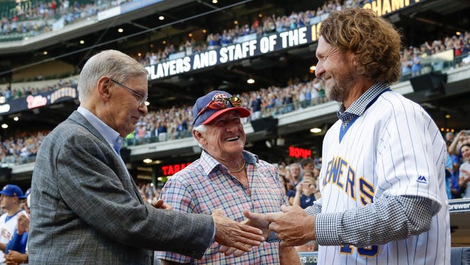 Bud Selig (left) and radio announcer Bob Uecker (center) shake hands with Robin Yount before the Brewers-Phillies game on July 15 at Miller Park.
