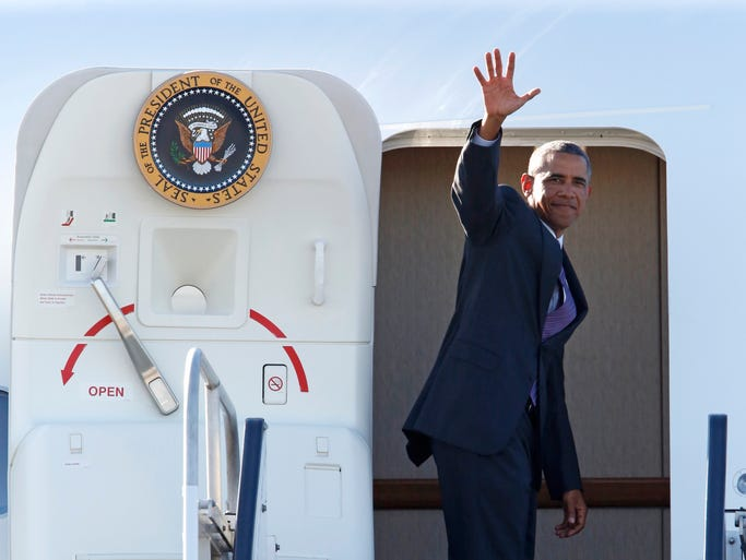 President Barack Obama waves before boarding Air Force