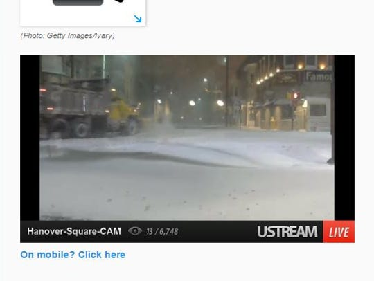 A snow plow clears snow on Broadway shortly after 4:30