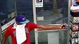 One of the suspects in an armed robbery in the 100 block of West Gloria Switch Road