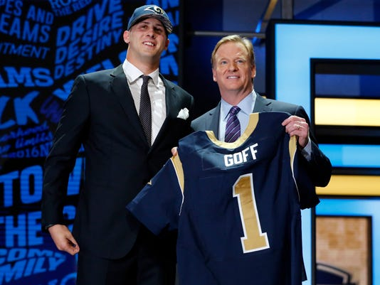 California's Jared Goff poses for photos with NFL commissioner Roger Goodell after being selected by the Los Angeles Rams as the first pick in the first round of the 2016 NFL football draft, Thursday, April 28, 2016, in Chicago. (AP Photo/Charles Rex Arbogast)