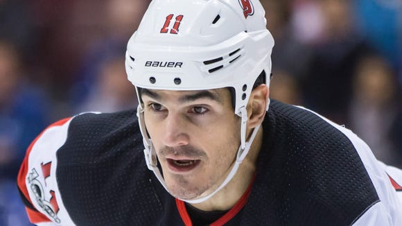 New Jersey Devils' Brian Boyle lines up for a face-off