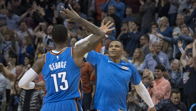 Paul George and Russell Westbrook of the Oklahoma City Thunder celebrate during the second half of a game against the Golden State Warriors.