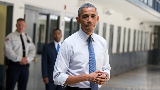 In this July 16, 2015, file photo, President Obama pauses as he speaks at the El Reno Federal Correctional Institution in El Reno, Okla.