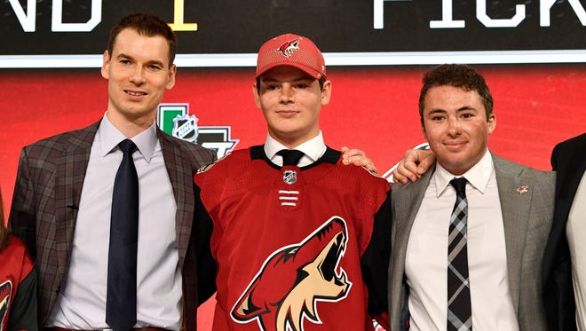 Jun 22, 2018; Dallas, TX, USA; Barrett Hayton poses for a photo with team representatives after being selected as the number five overall pick to the Arizona Coyotes in the first round of the 2018 NHL Draft at American Airlines Center.
