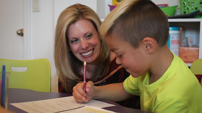 Stacy Lynn Costa, owner of School Answers Academic Success Center in Colts Neck, works with Christopher Jordan, 9, of Colts Neck.